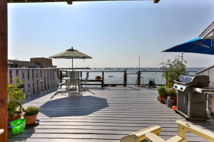 Exclusive deck area connects with largewaterfront common decking area; steps to the beach ...