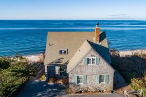 Welcome to 1 Carver Rd, Brewster, MA perched above the dunes overlooking it's own private beach.