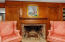 The wood burning fireplace is the centerpiece of the parlor.
