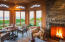 Clear red cedar v-grove walls and wood burning fireplace, makes this a favorite room