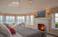 Custom designed master suite with circular windows overlook both the ocean and harbor.
