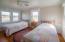 2nd floor bedroom with views of marsh