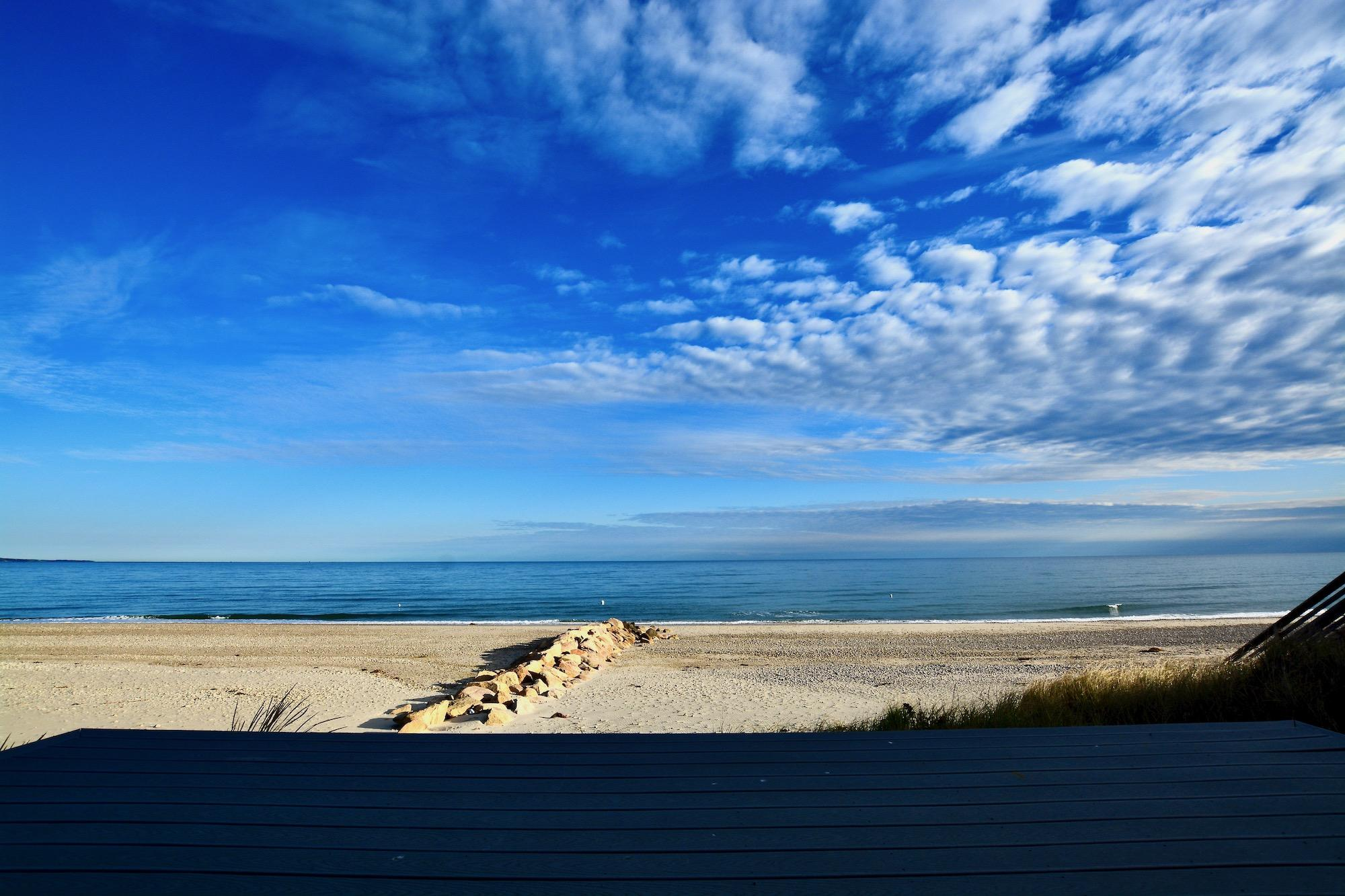 NEW CONSTRUCTION! Pre-completion custom Cape Cod Bay Beachfront property sitting atop the refined white sands north of historic RT 6A. Nestled in the dunes await's this idilic cape cottage style 2 bedroom, 2.5 bath waterfront home. Surround yourself in high end craftsmanship and detail as you glide through the open floor plan, humbled by the surreal long views. Tantalize the senses as you enter the great room with solid hardwood floors encapsulated by classically elegant wainscoting, stunning natural quartz and shimmering stainless appliances. Witness one of the most brilliantly majestic sunsets as it melts into the calming bay waters from your master bedroom roof deck, three season porch bar, expansive first floor azek deck, or fire-side on your private beach with toes in the sand. Amongst the backdrop of the bay, warm your body and soul in front of the field stone gas fireplace. Catch yourself as your eyes are continuously drawn to the artisan details of the custom constructed ceilings. This location warrants ones deep appreciation for the cape, its natural beauty and elegance. Investors take note of the rental potential a property of this magnitude can generate.