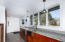 Kitchen with cherry cabinets and apron sink