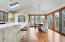 Kitchen/Dining Rooms. Awesome hardwood flooring and slider access to a deck. Wonderful cathedral ceilings, 2 skylights and walls of windwos offer awesome light.