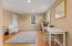 Den. First floor bedroom is accessed via the viewable door.