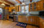 Kitchen features solid wood cabinets with stainless steel appliances, gas cooking and granite counter