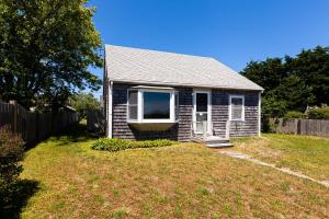 The Front Of This Little Cottage Faces Cape Cod Bay.