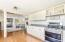 Kitchen flows into family room.