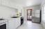 Kitchen showing door to exclusive use granite paver patio