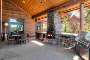 The outdoor kitchen and fireplace is a gather spot for all