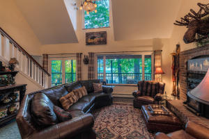 Looking at the lake with lots of windows and vaulted ceilings give you space and wide open lake views