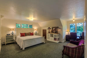 This is your own special retreat with a cozy desk area with incredible lake views, walk-in closet and private en-suite bath.