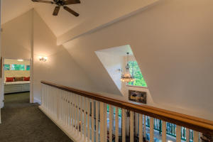 Vaulted ceiling and dormer windows add an open easy feel, ceiling fans, custom light fixtures add to the many touches