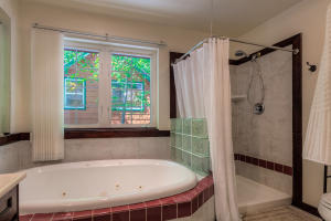 Boasting a jetted tub, shower and abundant light, this master en-suite is a treat.
