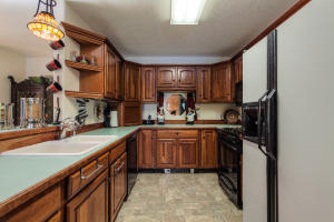 Kitchen has lots of cabinets and a great, feel.