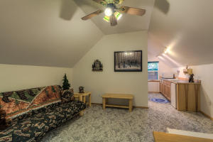This is a kitchenette (no stove) with sink and bedroom above the garage. Bathroom is in lower level garage