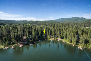 Quiet cove of year round living with 3 parcels for your own private lake living on stunning Hayden Lake