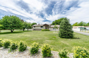 Sits on a .97 Acre Lot with a nice 40 X 36 Shop and meticulously maintained yard with fruit trees and and a varietal flower and rose garden.