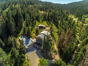 Incredible secluded 10 Acre horse property with a unique custom home with just under Just under 7,000 SQFT including another full living area!
