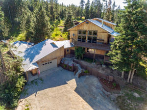 This Multilevel Craftsman style home sits just below the tree tops offering incredible views!