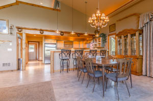 Dining area has a beautiful chandelier and flows right into the kitchen with a nice breakfast bar.