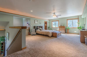 Fantastic Over- sized open Master suite that overlooks down into Great room. Beautiful custom wood accents with lighting along top border.