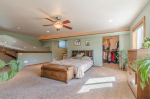 Nice office space to the left behind bed and to the right is a large walk in closet.