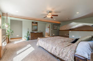 2 open entryways to Master Bathroom Suite with a walk in shower, nice soaking tub and a walk in Sauna.