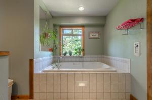 Nice sized soaking tub in master bathroom suite