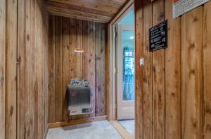 Custom built walk in sauna with unique reclaimed wood