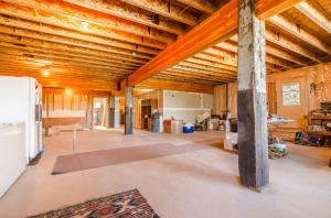 Partially finished basement with more historic features with wood beams from Ohio Match