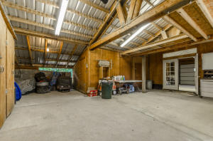 2 car garage that attaches main home to a complete additional 1 bedroom living area.