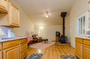 Nice wood stove, laminate floors and full kitchen