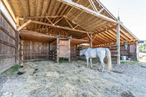 Open Horse shelter. Can be expanded and enclosed easily. Owner leaving several trusses.