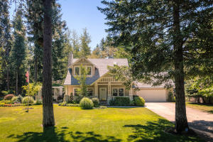 Spectacular Outdoor and indoor spaces for extraordinary living in Hayden Lake right on the corner of Easy St and Hayden Ave only a short cart ride to two golf courses, the Hayden Lake Country Club and so much more!