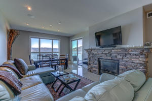 This great room has it all.....cozy fireplace for snowy nights and the balcony for balmy summer nights