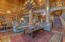 Massive logs and ornate design elements blend to create a one of a kind great room