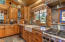 With deep sink, gas stove, granite counters and plenty of storage