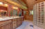 With beautiful stained glass window, large vanity, and built in linen cabinet.