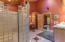 Describes the glass block walk-in shower with double shower heads