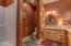 A nicely appointed 3/4 bath with dual vanities and built in features