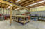 The 1148 SF workshop is beneath the garage and is large enough for any project