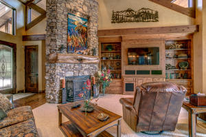 The striking stone fireplace draws the eye to its beauty