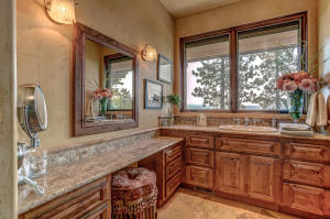 With a lighted vanity and an abundance of storage space