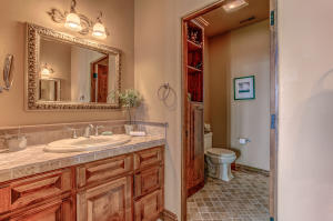 With two vanities, walk-in shower, and linen storage