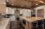 Kitchen with Thermador appliances, massive granite island