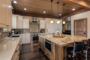 Kitchen with Thermador appliances, massive granite island