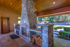 With built-in gas grill, wood fireplace, and food prep counter