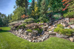 Beautiful waterfalls cascade throughout the front yard landscaping